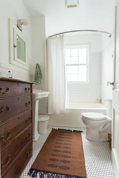 Their bathroom with soothing colors and one-of-a-kind vintage pieces. This room was completely renovated by Tyler and went from black and red to calm and serene.
