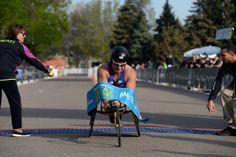 Description of . Brad Ray wins the wheelchair division int he 1/2 marathon at the 9th annual Colfax Marathon May 18, 2014. The 26.2 mile Marathon runs through Denver's iconic landmark Mile High Stadium (twice), Sloan's Lake, City Park, Colfax Avenue through Lakewood and Aurora. The Marathon started and finished in City Park where runners enjoyed the rest of the day listening to music by Chris Daniels and the Kings. (Photo by John Leyba/The Denver Post)