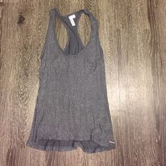 Gray glitter tank High low hemline with a front pocket. worn once Hang ten Tops