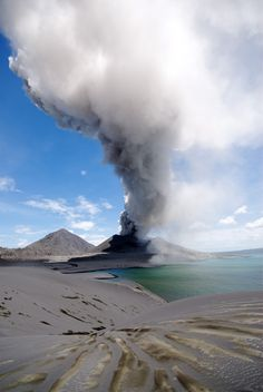 Tavurvur Vent of the Rabual Volcano in PNG erupting. This volcano is one of the most active & dangerous volcanos in Papua. Rabaul exploded violently in 1994 & devastated the city of Rabaul. Since then, the young cone Tavurvur located inside the caldera has been the site of near persistent ash eruptions
