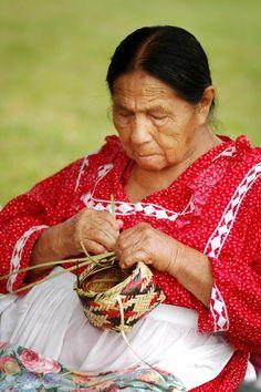 Choctaw woman making baskets