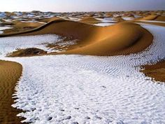 Snow in the desert of Algeria. Looks very surreal.