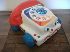 https://flic.kr/p/8tWcAa   Fisher Price Chatter Phone Cake   A belated bday pressie cake for my sister, we both LOVED this little guy as kids and as he has been reanimated and brought back in to vogue in Toy Story 3, Kelly thought it would make a great cake. I really enjoyed doing this one, although wanted to get liquorice for the cord on the receiver - could not find them anywhere!!!! prob could have ordered them online but as per I left it all to the last minute lol The handset was a bit…
