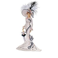 """""""Victorian Promenade"""" Figurine Collection. A FIRST! Limited-edition Victorian lady figurines with etched lace, real feathers and faux gems, inspired by the fashions worn at elite horse races."""