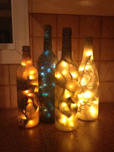 Wine bottle Christmas lanterns... The blue was an experiment and I love it!!!  Frosted spray paint is sooooo important (in my opinion!!)