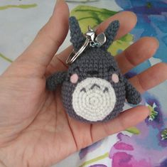 Totoro keychain| Crochet totoro keychain | Handmade crochet keyring | Amigurumi totoro| crochet totoro|white totoro| Totoro charms  Get your very own mini forest God  (the grey Totoro) or the itty bitty tiny white buddy to go! The grey charm comes with a little bell so he can jingle along as you go about your day, and the little white one just tags along where ever you go in silence (hes busy trying to catch up to you) , just like the movie.   PLEASE NOTE THAT THIS IS NOT A SET AND THEY ARE…