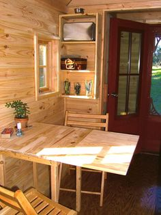 Tiny Houses: Living Large in a Small Space: Furnishings that can be collapsed or tucked away when they're not in use give a small home the flexibility it needs. The drop leaf on this table, which sits snug with the wall so as not to waste floor area, folds up or down depending on the homeowners' needs. From DIYnetwork.com