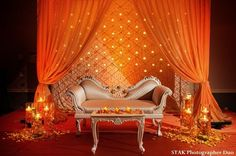 Very beautiful. Although I'd want something more like the pic that follows, I love the candle backdrop and the couch.
