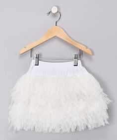 Take a look at this Ivory Shag Skirt - available also in pink and black! Would be SUPER cute for spring/summer pics!