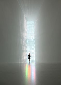 Interior view of Tokujin Yoshioka's Rainbow Church. A 9-meter-high stained glass installation made with approximately 500 crystal prisms fill the space with rainbow colors as the light shines on it.