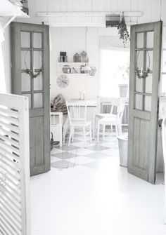 Beautiful grey doors - and lovely floor.  Murder to keep clean?