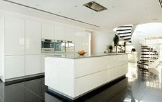 High Gloss White Kitchen with Miele Appliances and Corian Worktops