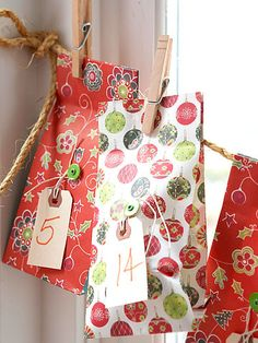 Advent Gift Bags. I got an idea like this from my Martha magazine. Now to think of fillers...