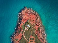 Taken at Gantheaume Point in Western Australia.  This point is right at the edge of town and offers jagged rocks which are popular cliff jumpers much to the annoyance of the locals.
