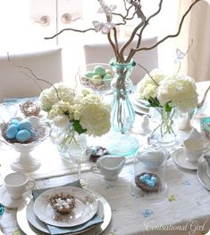 Twigs, white mums and light blue eggs create a gorgeously, understated Easter table. Beautiful crafts, recipes and more can be found at http://www.paaseastereggs.com/index.php