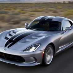 The Dodge Viper VX was unveiled at the 2012 New York Motor Show by the American car company Chrysler. The went into production in 2013 and is available as a Coupe. Check Out This Amazing Dodge Viper Video Next Page: Viper Engine and Specifications 2017 Dodge Viper, Dodge Srt, Dodge Challenger, 2018 Dodge, Cool Muscle Cars, New Viper, Viper Gts, Us Cars, Sport Cars