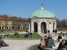 The Hofgarten in Munich, Germany, is a very popular spot, shown here on the first sunny weekend in spring. The garden was built in 1613-1617 by Maximilian I, Elector of Bavaria as an Italian style Renaissance garden. In the center of the garden is a pavilion for the goddess Diana, built in 1615 by Heinrich Schön the elder.