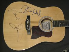 Guitars Signed by Artists These signed guitars are one-of-a-kind and waiting to hang in your music studio, living room, bedroom, or anywhere else you want to appreciate your favorite artist's autograph. I love music.  I would have especially l