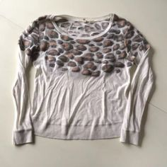 """Moth anthropologie  leopard print sweater top s This is a beautiful """"Leo"""" sweater by Moth from Anthropologie. It is an off white color and has gray and pink raised leopard print across the top. Crewneck and long sleeves. Retails for $98. Size S. 43% cotton, 17% polyester, 17% modal, 10% wool, 6% silk, 4% acrylic, 2% nylon, 1% spandex. Hand wash, dry flat. One pull on sleeve by hem.  Shoulder to shoulder: 17""""-21"""" Arm pit to arm pit: 18""""-25"""" Waist: 16""""-25"""" Shoulder to hem: 21"""" Sleeves: 22.5""""…"""