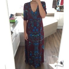Somedays Lovin maxi dress Unique maroon maxi dress with a blue and green floral print. Doesn't have a zipper but has four buttons down the front to help with getting it on and off. Also has two slits up the front of the dress that go to just above the knee. There's a very small hole along the seam which is probably from the store's sensor. It's never been worn but doesn't have the tags because I bought the dress without them. 100% viscose Somedays Lovin Dresses