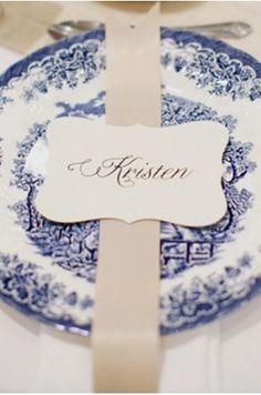 use colored ribbon and a shaped paper for name cards on top of blue willow china #bluewillow #wedding