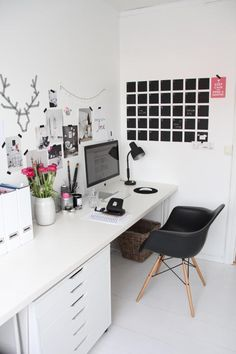 Love this work space; desk that fits the width of the room, the Eames chair, the blackboard.