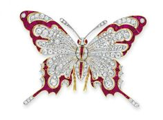 A DIAMOND AND RUBY BROOCH   Designed as an old European and single-cut diamond butterfly with calibré-cut ruby detail, mounted in gold and platinum