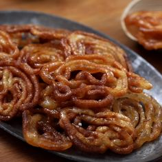 Homemade Jalebi - Thin and Crispy! Learn how to make homemade jalebis that are crispy and thin with Indian Dessert Recipes, Indian Sweets, Indian Snacks, Sweets Recipes, Soup Recipes, Snack Recipes, Cooking Recipes, Easy Cooking, Breakfast Recipes