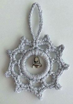 Sep 2012 - Pretty up your packages with handmade ornaments! Find the pattern for this quick and easy crochet garland ornament at Chalky's World . Crochet Snowflake Pattern, Crochet Motifs, Christmas Crochet Patterns, Holiday Crochet, Crochet Snowflakes, Crochet Gifts, Diy Crochet, Crochet Angels, Crochet Stars