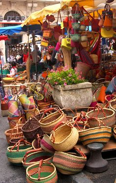 Provence-Alpes, Cote d'Azur, France;  colorful baskets; open air markets; organized chaos; the mix of old and new things