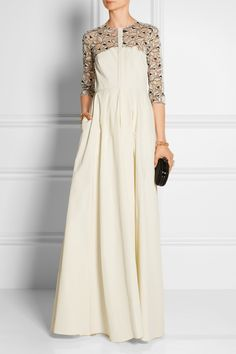 The bodice and skirt err on the plain side, but it's still an interesting dress. (Lela Rose|Lace-paneled Poplin Gown)