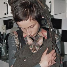 dreads tattoos and a hairless cat, does it get any better?