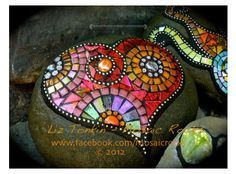 Glassmosaic on rock....this could be polymer.! Made by Liz Tonkin