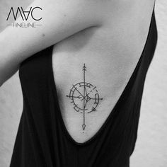 compass tattoo on rib