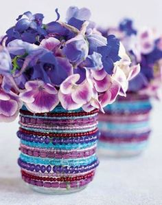 DIY Beaded Vase  Love these elastic bead bracelets encircling old tin cans (or baby food jars).  Link for Country Living no longer words but could be easy to figure out.