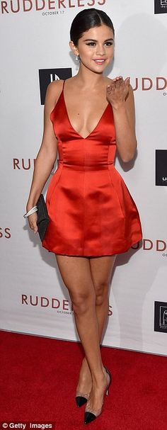Selena Gomez flashes serious cleavage in plunging mini-dress #dailymail