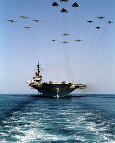AMAZING SEA LEVEL BOW ON LOOK AT AIRCRAFT CARRIER WITH 16 MILITARY JET FLY OVER IN FORMATION!