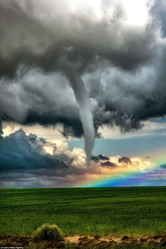 Storm collision : darkness meets light - tornado and rainbow - amazing weather photography - mother nature Image Nature, All Nature, Science And Nature, Amazing Nature, Nature Pictures, Cool Pictures, Cool Photos, Beautiful Pictures, Amazing Photos