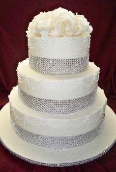 white lace , diamante and roses wedding cake