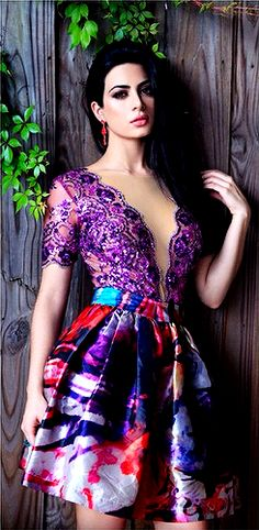 Emeraude Toubia wearing a short formal gown.  Purple lace bodice and multi colored floral skirt. | @gaby_cantoo