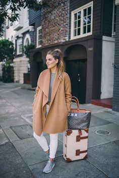 Outfit Details: Vince Coat (sold out, similar here and last seen here), Ralph Lauren Sweater, Frame Jeams, Nike Sneakers, Goyard Tote Bag, Steamline Luggage Carryon  As someone who travels often, I'v
