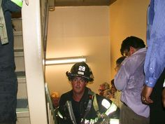 "9/11 Firefighter  Photo: John Labriola    While most able-bodied occupants of the north tower fled down stairwells to safety, firefighters such as Mike Kehoe (pictured) headed up to help the wounded.    Kehoe's Ladder 11 firehouse lost six men that day, but he survived to face a life forever changed not only by 9/11 but by the iconic image in which he unwittingly appeared.    ""In some ways Mike Kehoe came to symbolize the firefighters,"" Chanin said.    Published September 8, 2011"