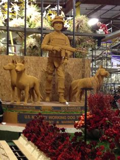 Floral replica of military working dog monument
