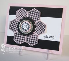handmade card ...  black, white and pink .... gingham pattern stamped hexagons ... black ink on pale pink ... punched and mounted in the quilt flower pattern ... bottle cap medallion ... pretty card ... Stampin' Up!