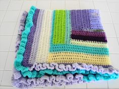 Crochet log cabin baby blanket multi rainbow colored with ruffle border by AuntieJenniesAttic on Etsy