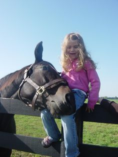"""Famous race mare Zenyatta, known as """"The Queen"""" of the """"Sport of Kings"""" shows her sweet side to a young fan."""