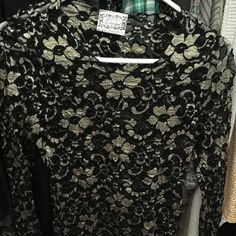 Black and gold lace top. Sz small Re posh. Never wore it. So cute though. My shoulders are too broad. :( Tops Blouses