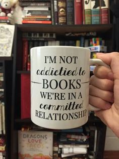 """""""I'm not addicted to books. We're in a committed relationship."""" I must find this mug."""