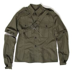 This British Army womens WWII jungle shirt is eerily reminiscent of the McLaren Westwood 'Seditionaries' parachute shirt, even down to the rubber buttons. The belt looped through the epaulette, the removable sleeves, and the stamped 'GAS FLAP' all add to it's Punk 'bondage-like' appearance. The shirt also features wrist buckles, pleated chest pockets, and reinforced shoulders. Completely mint and unissued it's a great example of the humble origins of some of Punk's iconic DNA.