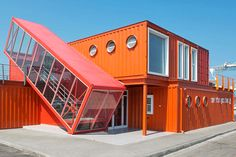 Angled shipping container houses a scissor staircase